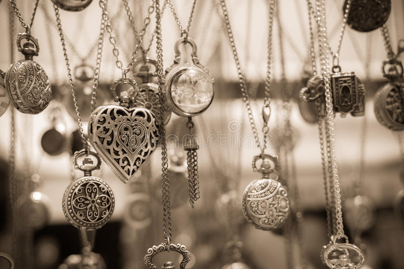 Vintage heart shaped pendant necklace among others stock image