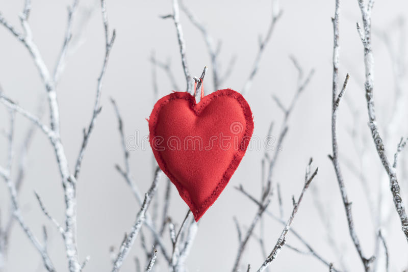Vintage hearts on branches stock images