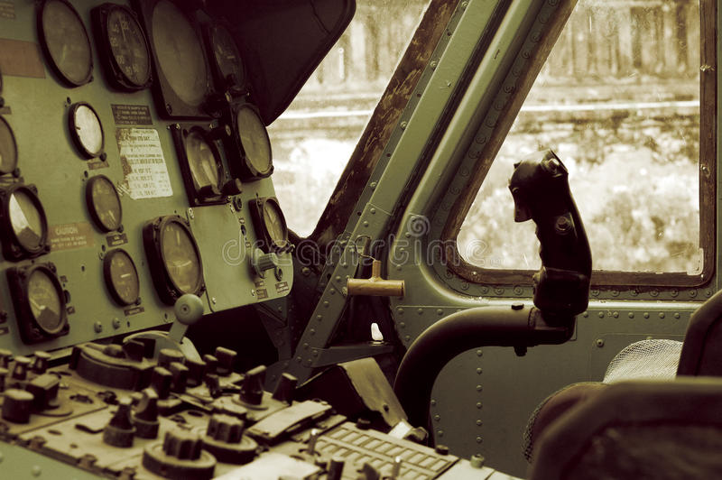 The vintage helicopter cockpit. The cockpit of a helicopter showing the controls, the product a long time ago royalty free stock photos