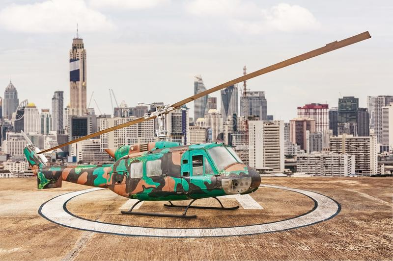 Vintage helicopter with town. Vintage helicopter at town on daylight royalty free stock photography