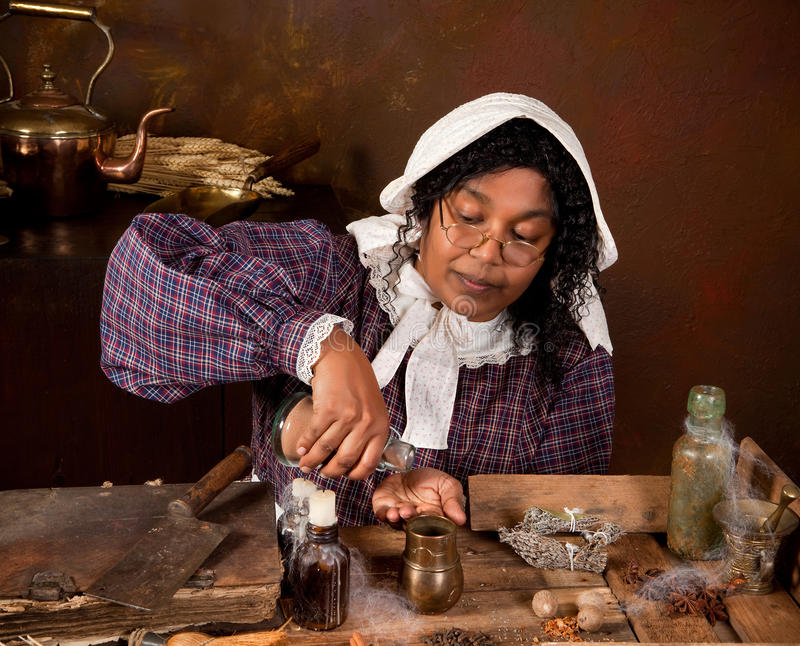 Vintage herb woman in kitchen stock photography