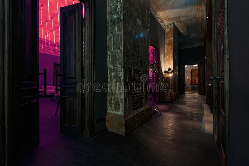 Vintage high doors in the mansion converted into a nightclub. loft style royalty free stock image