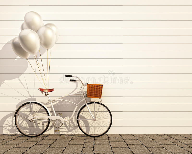 Vintage hipster bicycle with balloon in front of wall stock image