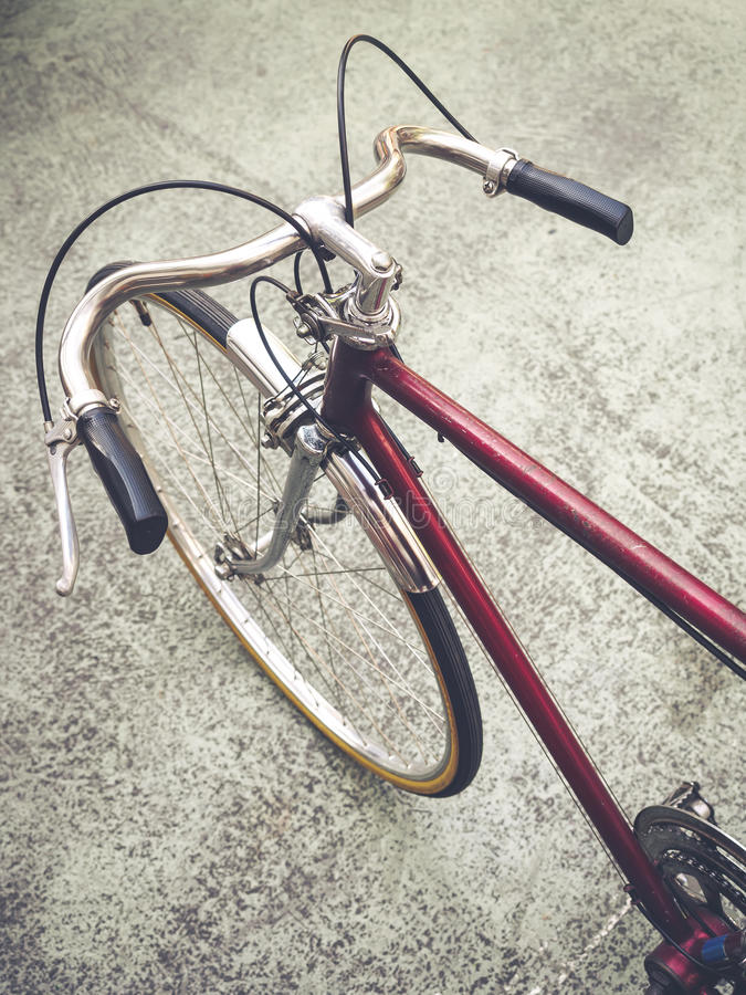 Vintage Hipster bicycle urban lifestyle. Vintage Hipster bicycle with hand and wheel royalty free stock images