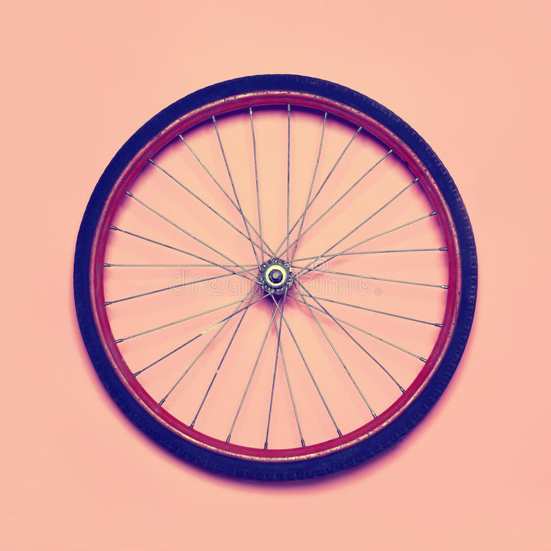 Vintage hipster photo bicycle wheel stock photography