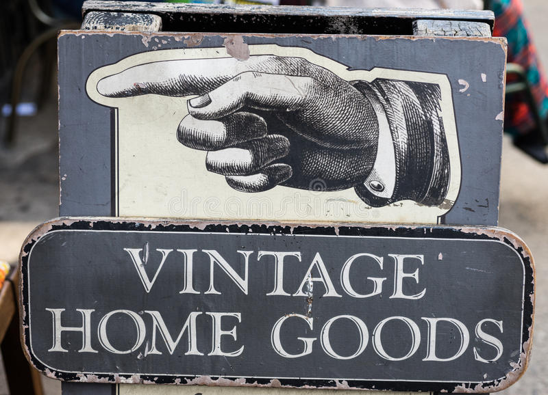Vintage home goods store sign. With pointing hand direction royalty free stock image