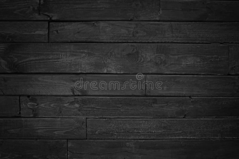 Vintage black wood textured. Vintage horizontal wood textured background. Wooden planks on a wall or floor with grain and texture royalty free stock image