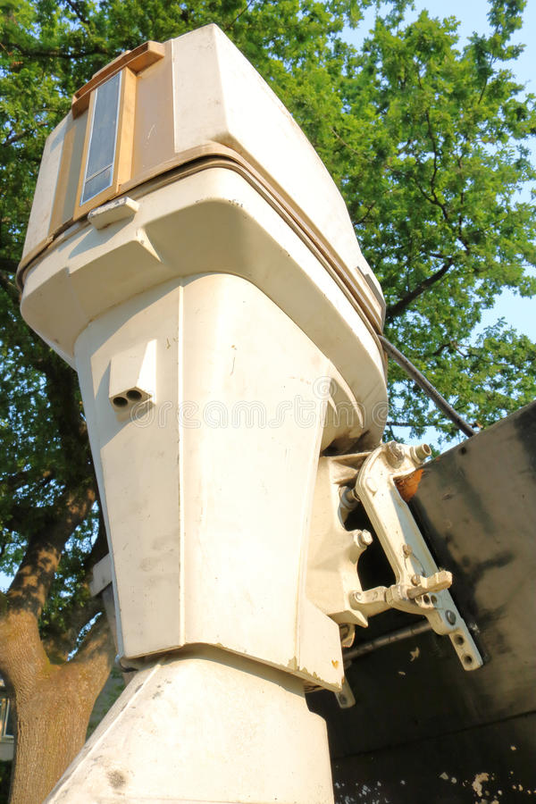 Vintage 75 Horsepower Outboard Motor. Vertical, low angle view of a vintage 75 horsepower outboard motor that is still in use royalty free stock photos