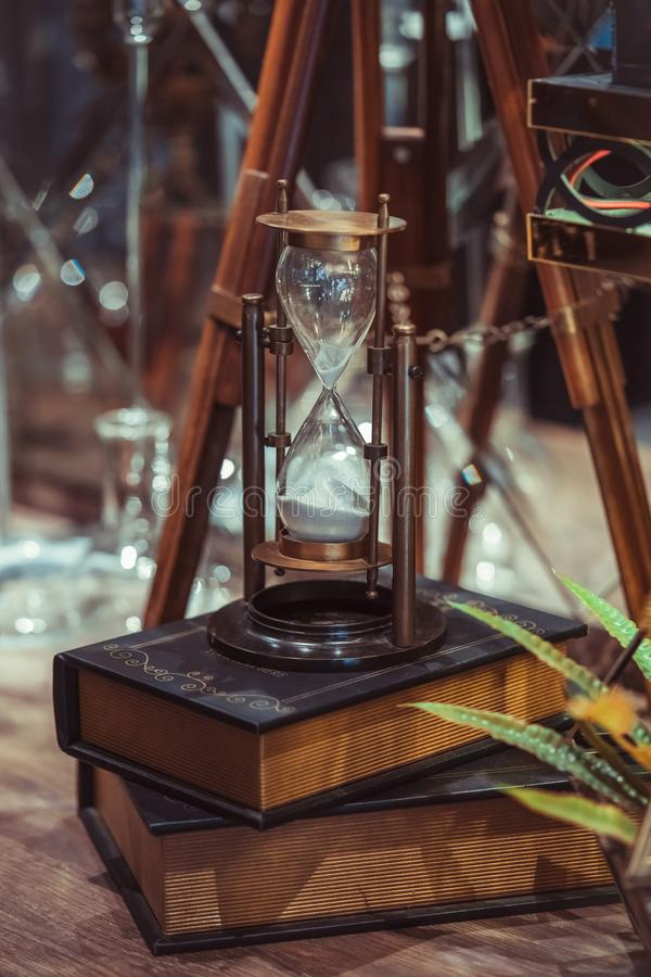 Vintage Hourglass Compass On Books royalty free stock images