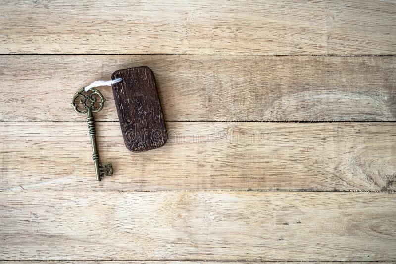 Vintage house key with wooden home keyring on old wood background. Copy space, heart, passion, notebook, text, texture, keychain, property, real, estate, sign royalty free stock photos