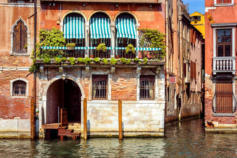 Vintage house, Venice, Italy. Entrance to residential house or hotel by Grand Canal, famous street of Venice stock photos