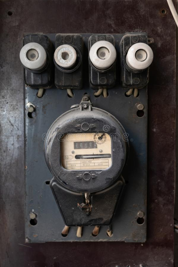 Vintage household electric energy meter with electric fuses royalty free stock photo