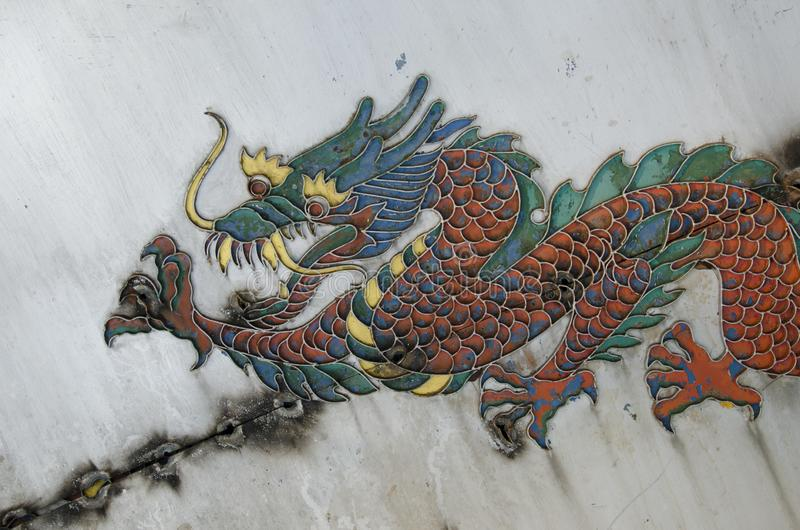 Vintage image of old colored dragon royalty free stock photography