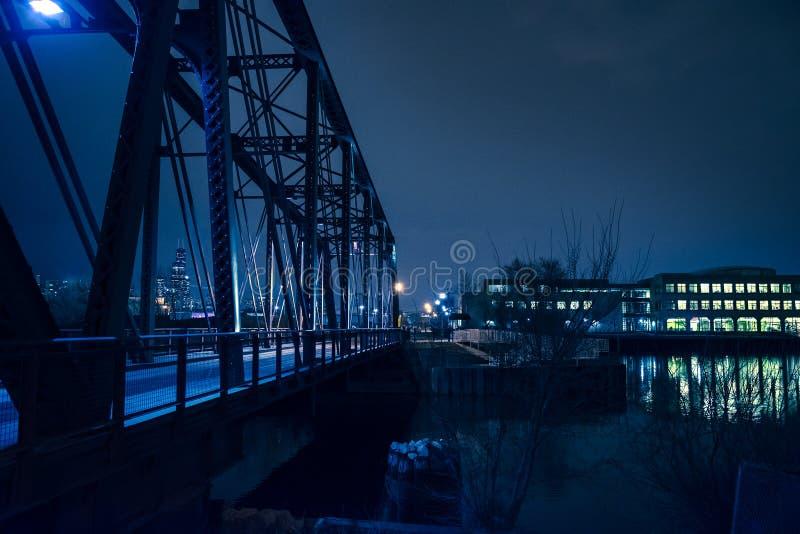 Vintage industrial railroad bridge at night stock image