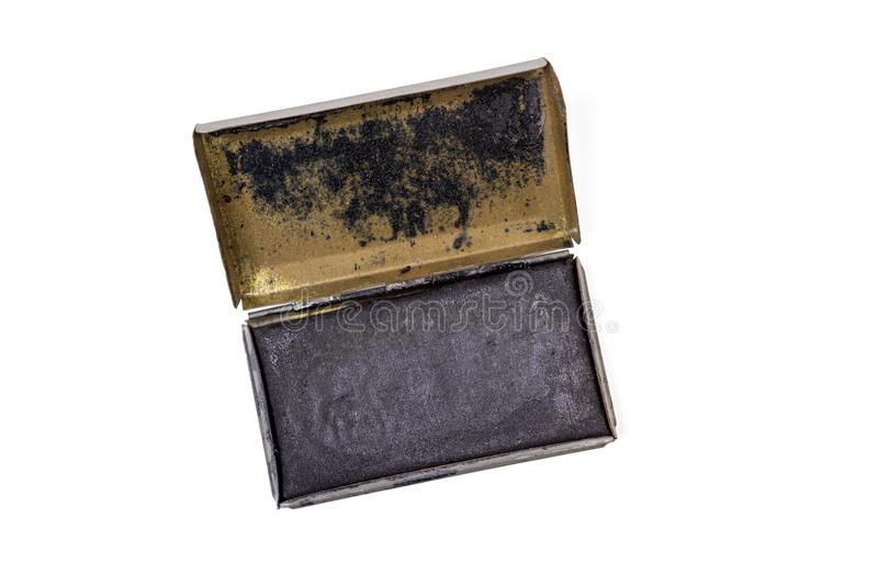 Vintage US Army Ink Pad. Vintage ink pad in a metal case, likely used in the US Army World War II, isolated on white stock images
