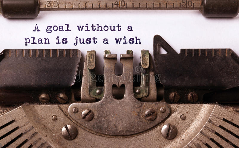 Vintage inscription made by old typewriter. A goal without a plan is just a wish stock photo