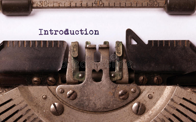 Vintage inscription made by old typewriter. Introduction royalty free stock photography