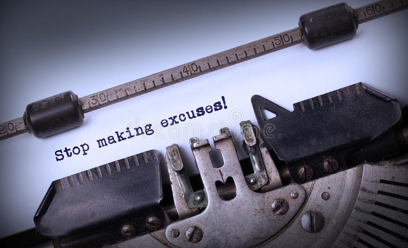 Vintage inscription made by old typewriter. Stop making excuses stock image