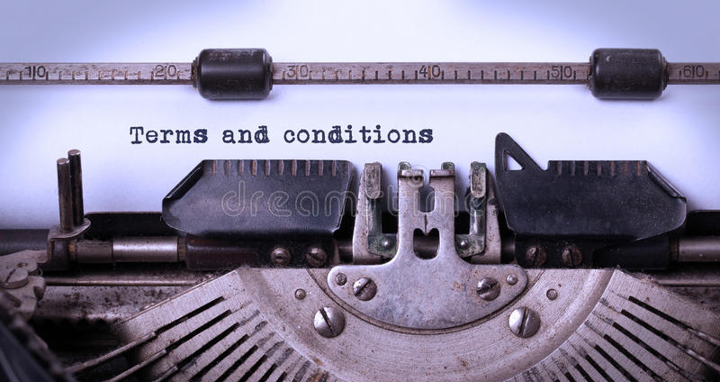 Vintage inscription made by old typewriter. Terms and conditions stock photography