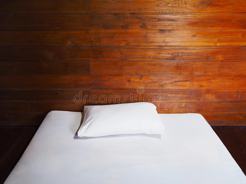 Vintage interior bedroom at wooden country house. Close up white futon and pillow on the floor in vintage bedroom at country wooden house stock photo