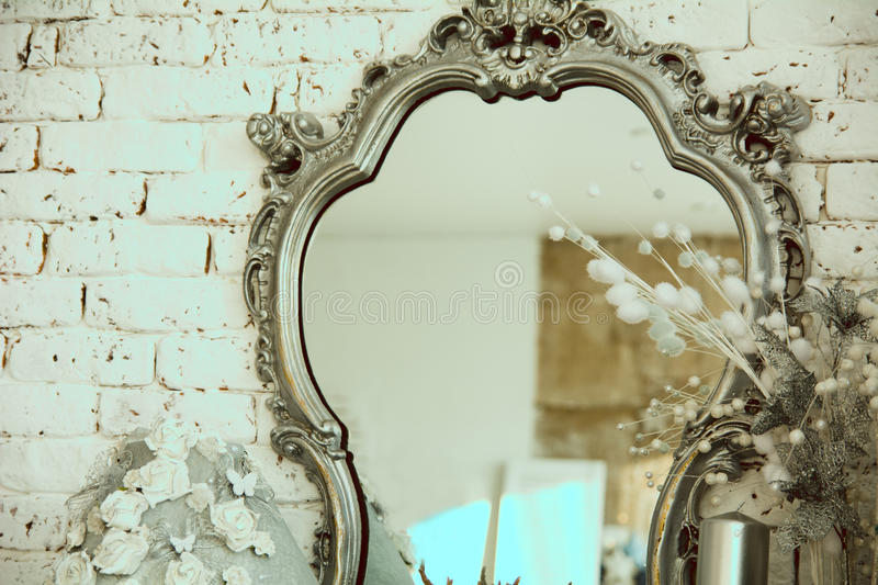 Vintage interior with a mirror in beautiful frame stock image