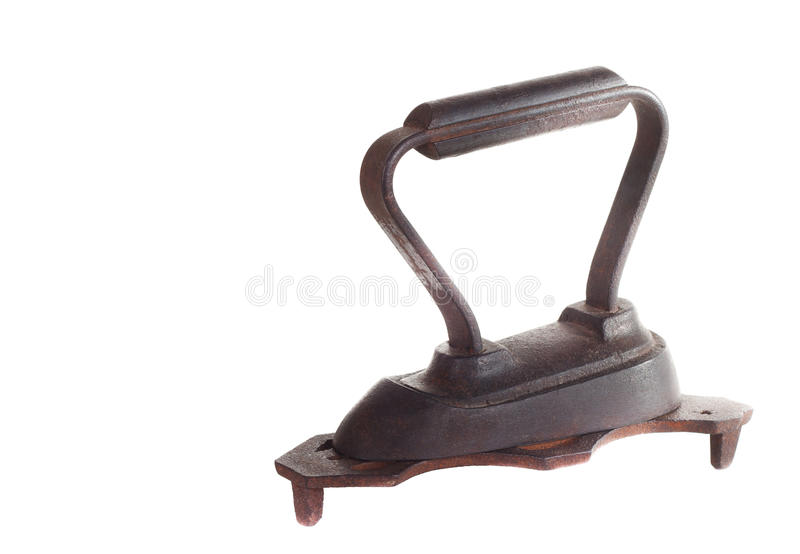 Vintage iron. Vintage rusty iron with support isolated on white background royalty free stock photography