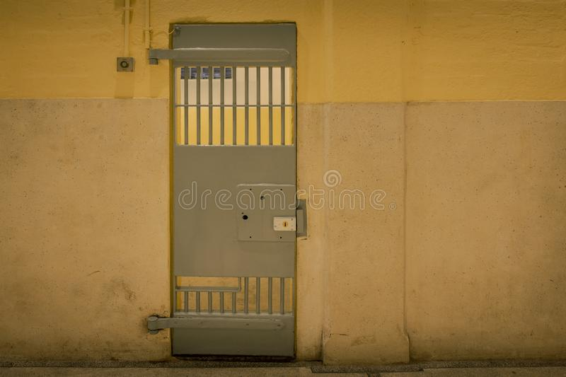 Vintage iron jail door in prison building with copy space in cinematic tone. Vintage iron jail door in prison building with copy space incinematic tone stock image