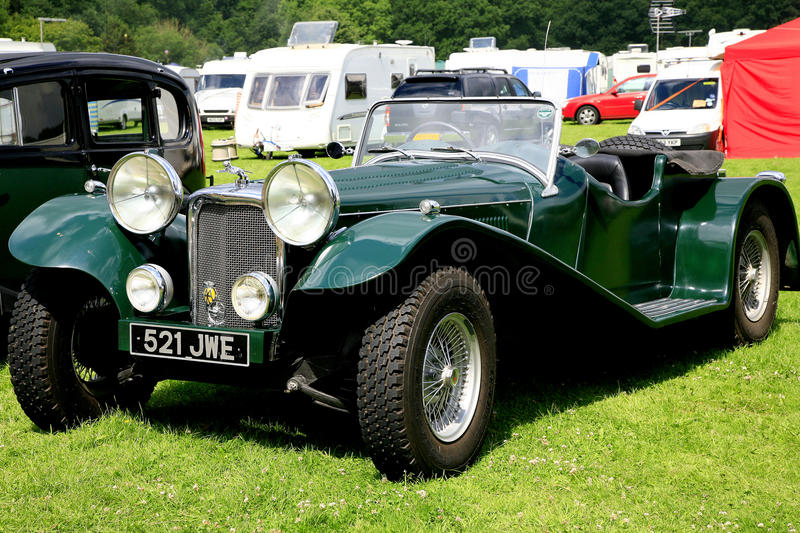 Vintage 1937 Jaguar roadster. ELVASTON, DERBYSHIRE, UK. JULY 04, 2015. Vintage 1937 Jaguar SS100 roadster on display at the Alveston country steam rally in royalty free stock images