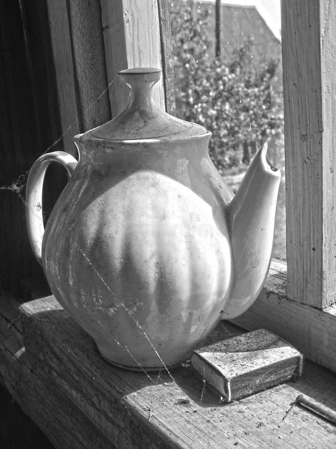 Vintage jug  stands on the windowsill filmed stock images