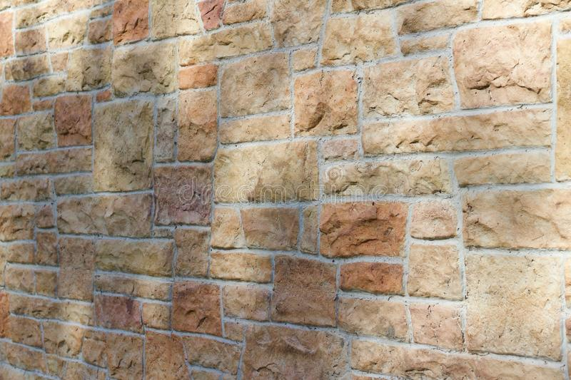 Vintage kasota limestone brick wall texture in colors of orange and pink beige stock photos