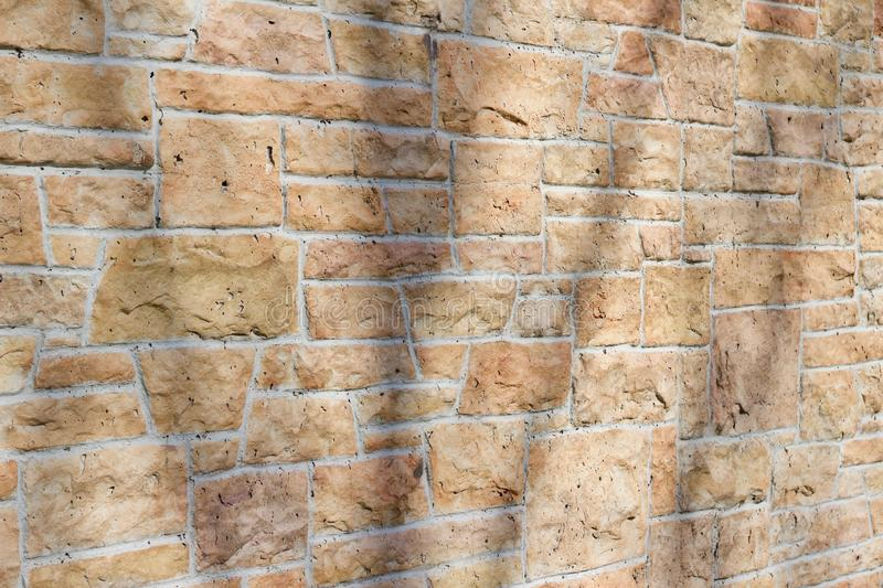 Vintage kasota limestone brick wall texture in colors of orange and pink beige royalty free stock photos