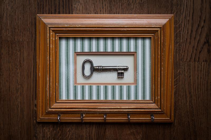 Vintage key holder with wooden frame royalty free stock photo