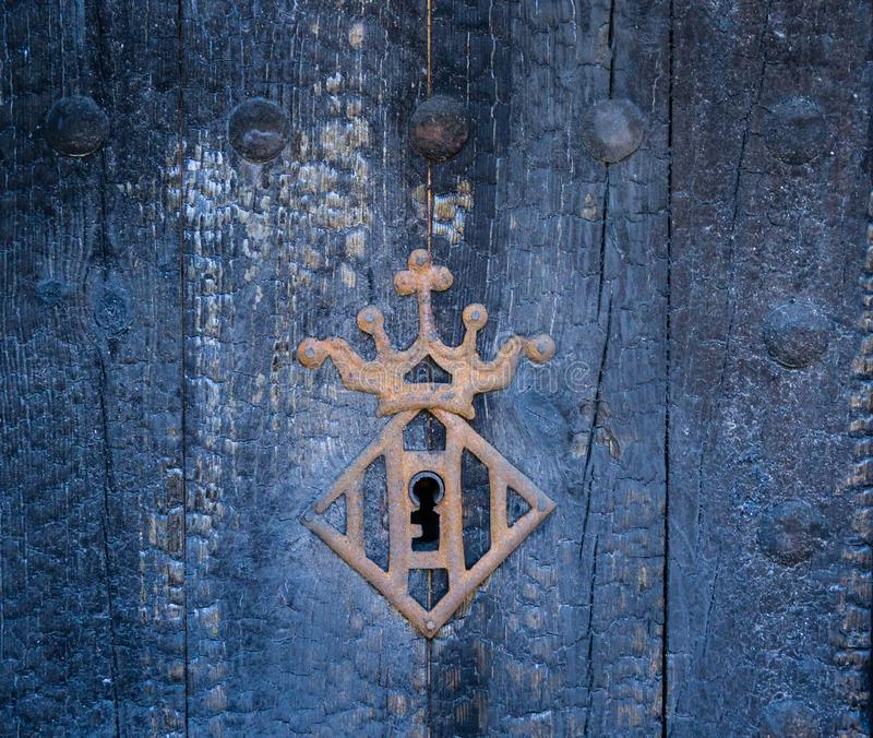 Vintage keyhole with a crown frame royalty free stock photos