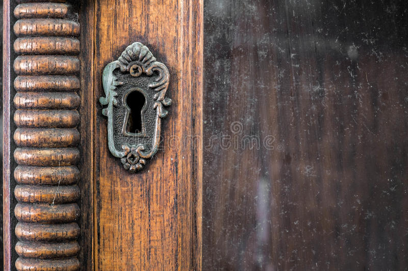 Vintage keyhole of vintage wooden cabinet. Vintage keyhole of nice vintage wooden cabinet royalty free stock photography