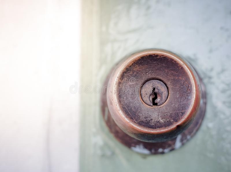 Vintage keyhole on wooden door background. royalty free stock photo