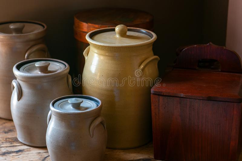 Vintage Kitchen Background, Crock Pots. Vintage kitchen farm background. Antique crock pots sit on a table in this farmhouse background scene stock photography