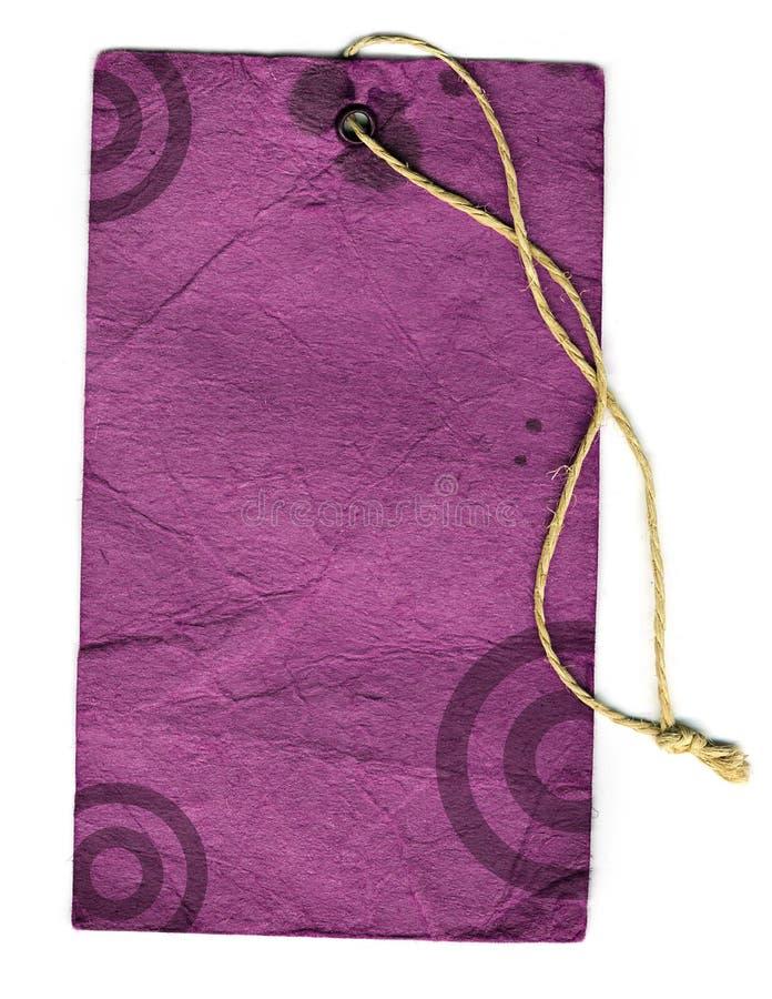 Vintage label. Violet vintage label with dark rings stock image