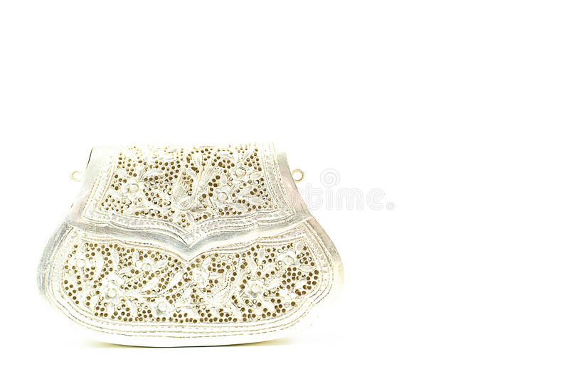 Vintage lady silver clutch handcraft carving handbag on white ba royalty free stock photography