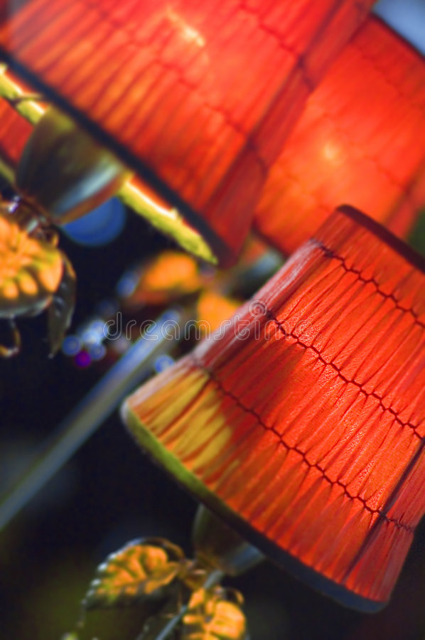 Vintage Lamp Shades. Vintage red smock-pleated lamp shades glow with light stock photography
