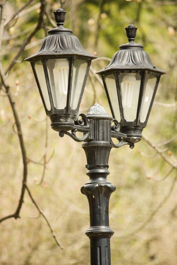 Vintage lamppost in Dimitrie Ghica park. Sinaia, Prahova county, Romania stock photography