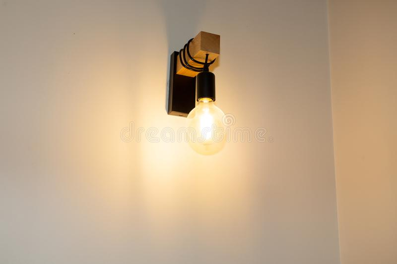 Vintage lamps hanging from the wall royalty free stock photo