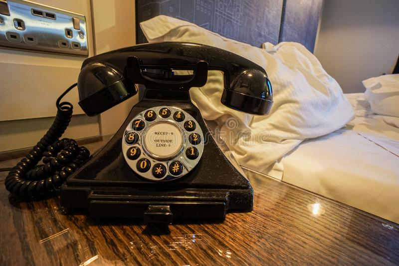 Vintage landline phone in bedroom luxury hotel stock photography