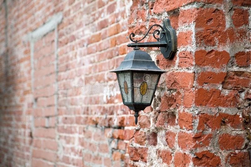 Vintage lantern on a red brick wall. Close up stock images