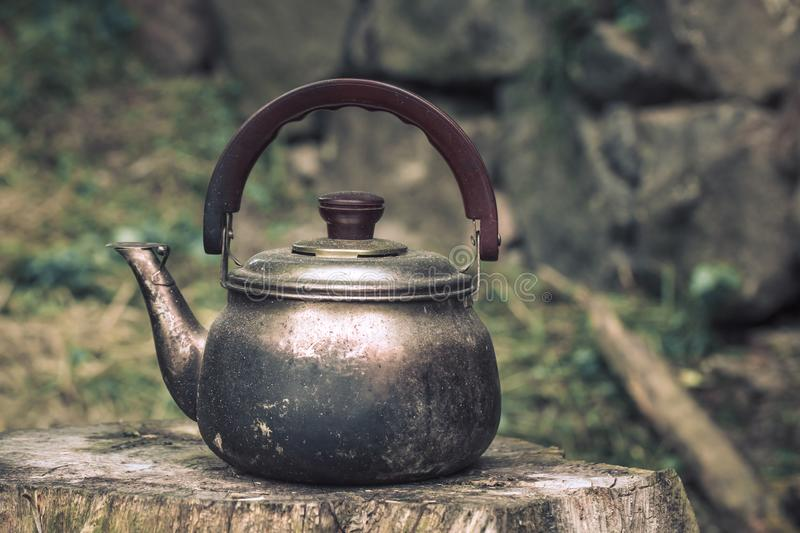 Vintage large aluminum tea pot kettle stove top isolated stock images