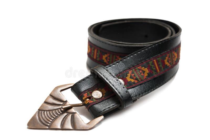 Vintage leather belt. Vintage black fashionable leather belt isolated on white background stock images
