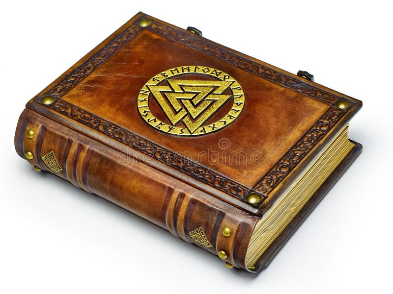 Vintage leather book with gilded Odin`s symbol, surrounded with runes. English translation of the runes is: A B C D E F G H I J K L M N O P Q R S T U V W X Y Z royalty free stock photography