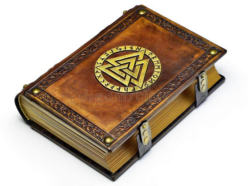 Vintage leather book with gilded Odin`s symbol, surrounded with runes. English translation of the runes is: A B C D E F G H I J K L M N O P Q R S T U V W X Y Z stock images