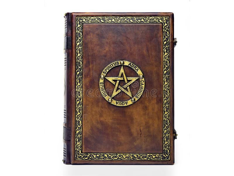 Leather book with gilded pentagram and decorative frame. Vintage leather book with gilded pentagram surrounded with Latin names of the five elements royalty free stock photos
