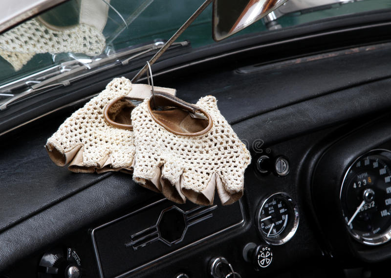 Vintage leather gloves for the vintage car race. White vintage perforated leather gloves for the vintage car race royalty free stock image
