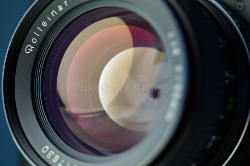Vintage lens front element close up macro shot with light reflections and visible closed  aperture blades stock image
